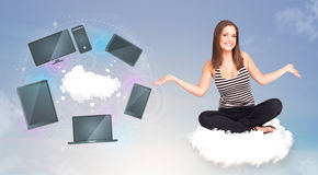 Young girl sitting on cloud enjoying cloud network service Stock Photos