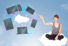 Young girl sitting on cloud enjoying cloud network service Stock Photography