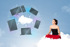 Young girl sitting on cloud enjoying cloud network service Royalty Free Stock Photo