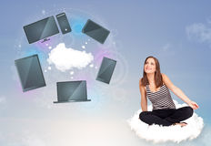 Young girl sitting on cloud enjoying cloud network service Royalty Free Stock Photos