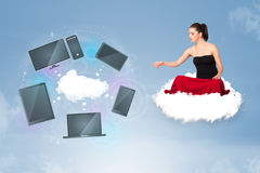 Young girl sitting on cloud enjoying cloud network service Royalty Free Stock Image