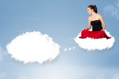 Young girl sitting on cloud and thinking of abstract speech bubb. Pretty young girl sitting on cloud and thinking of abstract speech bubble with copy space Royalty Free Stock Image