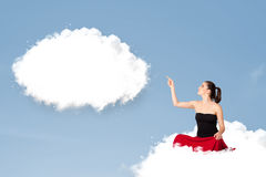 Young girl sitting on cloud and thinking of abstract speech bubb Stock Photography