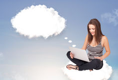 Young girl sitting on cloud and thinking of abstract speech bubb Stock Photos