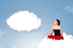 Young girl sitting on cloud and thinking of abstract speech bubb. Pretty young girl sitting on cloud and thinking of abstract speech bubble with copy space Stock Image