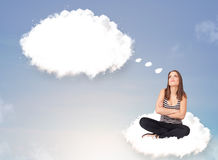 Young girl sitting on cloud and thinking of abstract speech bubb Stock Images