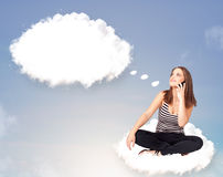 Young girl sitting on cloud and thinking of abstract speech bubb. Pretty young girl sitting on cloud and thinking of abstract speech bubble with copy space Stock Photo