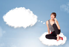 Young girl sitting on cloud and thinking of abstract speech bubb. Pretty young girl sitting on cloud and thinking of abstract speech bubble with copy space Royalty Free Stock Photo