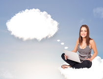 Young girl sitting on cloud and thinking of abstract speech bubb. Pretty young girl sitting on cloud and thinking of abstract speech bubble with copy space Stock Photos