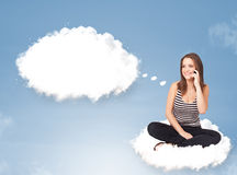 Young girl sitting on cloud and thinking of abstract speech bubb. Pretty young girl sitting on cloud and thinking of abstract speech bubble with copy space Stock Images