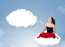 Young girl sitting on cloud and thinking of abstract speech bubb. Pretty young girl sitting on cloud and thinking of abstract speech bubble with copy space Royalty Free Stock Photography