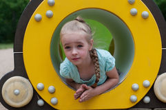 Young girl sitting in crawl tube Stock Photography