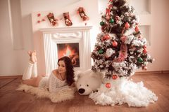 Young girl sitting beside the fireplace Royalty Free Stock Photography