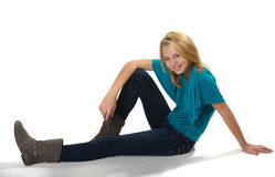 Young girl sitting on floor Stock Photo