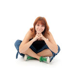 Young girl sitting on the floor Royalty Free Stock Image