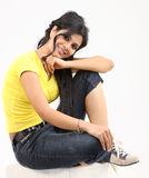 Young girl sitting on the floor Stock Photo