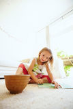 Young girl sitting on the floor drawing Stock Photo