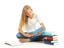 Young girl sitting on the floor reading over white background Stock Images