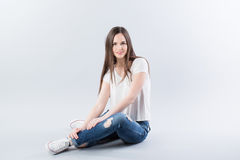 Young girl sitting on the floor royalty free stock photos