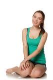 Young girl sitting on the floor. Studio. Stock Photo