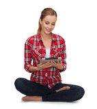 Young girl sitting on the floor with tablet pc Stock Image