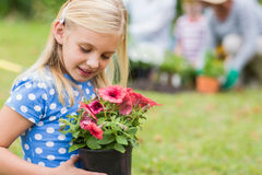 Young girl sitting with flower pot Stock Photos