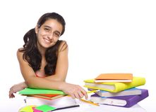Young girl sitting in front of her books Stock Photography