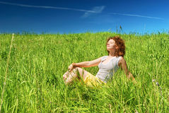 Young girl sitting on grass Stock Image