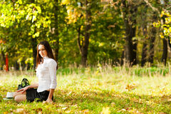 Young girl sitting on the grass Royalty Free Stock Photography