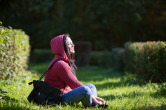 Young girl sitting on the grass Stock Photography