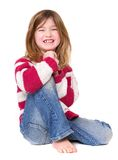 Young girl sitting and laughing Stock Photos