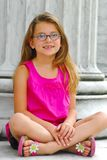 Young Girl Sitting on Marble Steps Royalty Free Stock Photos