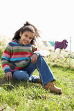 Young Girl Sitting Outside In Caravan Park Royalty Free Stock Image