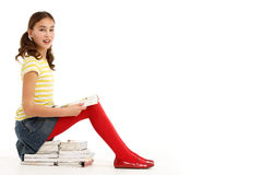 Young Girl Sitting On Pile Of Books Royalty Free Stock Photos