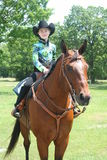 Young girl sitting on a quarterhorse Royalty Free Stock Image