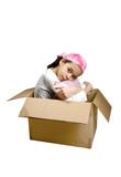 A young girl sitting quietly in a box Royalty Free Stock Photo