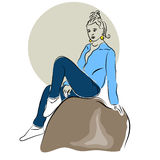 Young girl sitting on a rock. Royalty Free Stock Photo