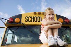 A young girl sitting on a school bus Stock Photos