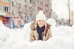Young girl sitting in snow Stock Photos