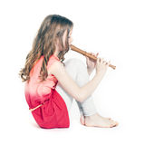 Young girl sitting with soprano recorder Royalty Free Stock Images