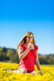 Girl in spring on a flower meadow with dandelion Stock Photos