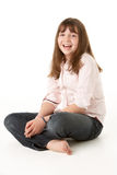 Young Girl Sitting In Studio Stock Photography
