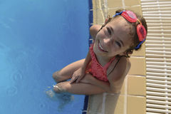 Young Girl Sitting at Swimming Pool Stock Photography