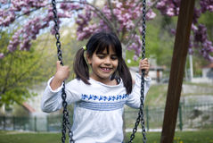 Young girl sitting on swing Royalty Free Stock Photography