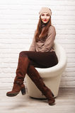 Young girl sitting in a white round chair Stock Image