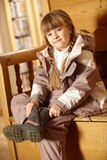 Young Girl Sitting On Wooden Seat Stock Photos