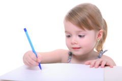 Young girl sitting and writing. Isolated beautiful young girl sitting and writing on white Royalty Free Stock Photography