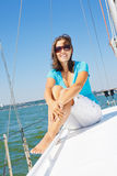 Young girl sitting on a yacht Stock Photos