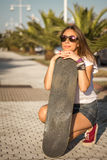 Young girl with a skateboard outdoor Stock Photography