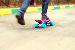 Young girl on skateboard at schoolyard Stock Photography